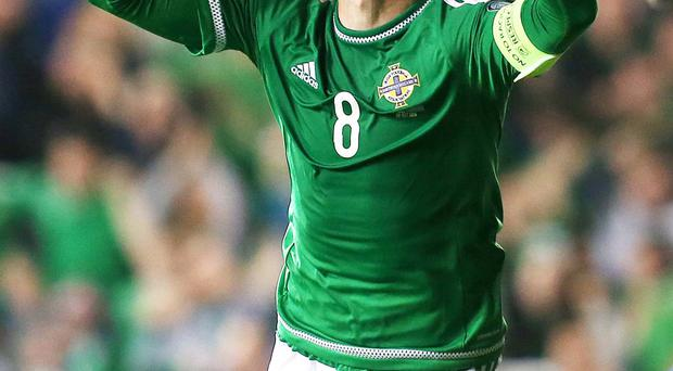 Paying tribute: Steven Davis has thanked his parents for all they have done for him