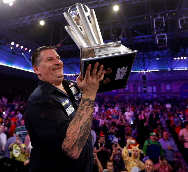 Just champion: Gary Anderson with the trophy after defeating Adrian Lewis 7-5 in the final of the PDC World Championship