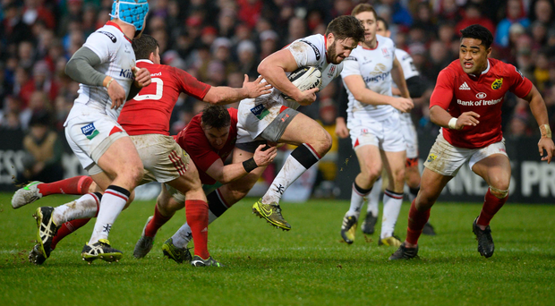 Held up: Ulster ace Stuart McCloskey is thwarted by Munster during the inter-pro clash at the Kingspan