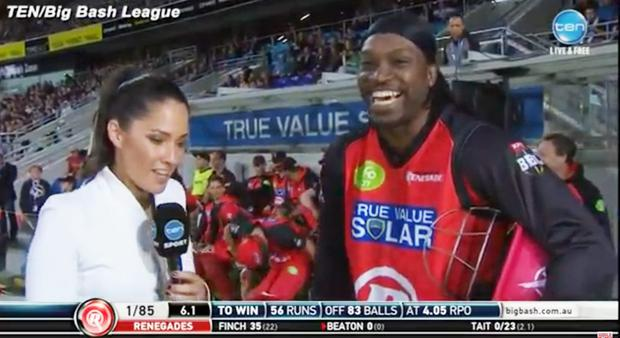 Sorry now: Chris Gayle smiles through his controversial TV interview with Mel McLaughlin