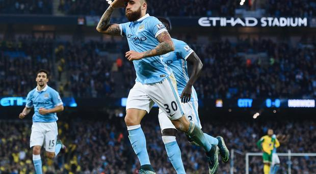 In his stride: Nicolas Otamendi's grit has been key for City