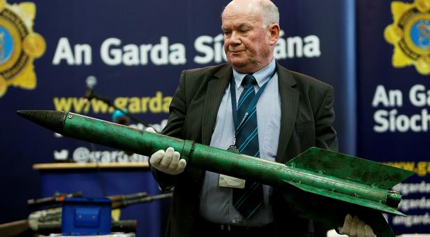Detective Sergeant Tom Carey, Ballistics holds an improvised rocket as samples of weapons seized during investigations into dissident republican activity in 2014 and 2015 go on display at Garda headquarters in Dublin.