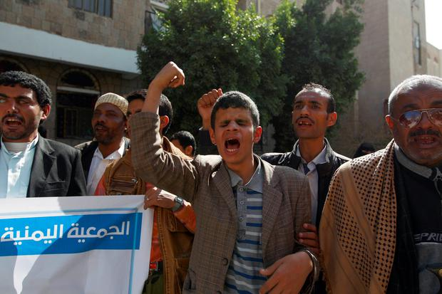 Yemeni blind men shout slogans during a demonstration gathering disabled people to protest after a centre for the blind was reportedly destroyed by Saudi-led airstrikes in the capital Sanaa on January 6, 2016. AFP/Getty Images