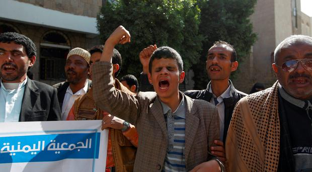 Yemeni blind men shout slogans during a demonstration gathering disabled people to protest after a center for the blind was reportedly destroyed by Saudi-led airstrikes in the capital Sanaa on January 6, 2016. AFP/Getty Images