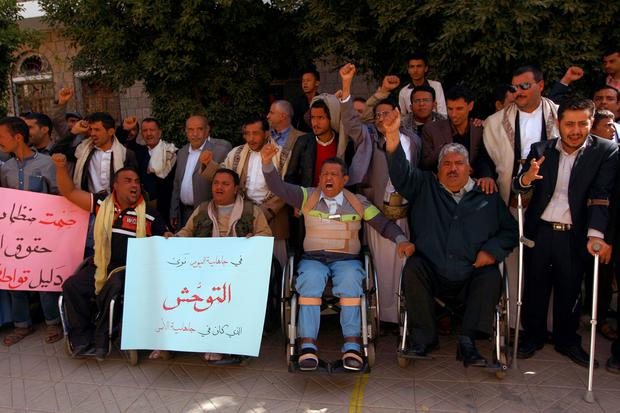 Yemeni blind and disabled people shout slogans during a demonstration to protest after a centre for the blind was reportedly destroyed by Saudi-led airstrikes in the capital Sanaa on January 6, 2016. Nearly 6,000 people have been killed since March, according to UN figures. At least 2,795 of them are civilians. AFP/Getty Images