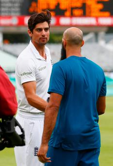 Leading men: England skipper Alastair Cook shakes hands with Hashim Amla after the South African revealed he would be standing down as skipper following the draw at Newlands