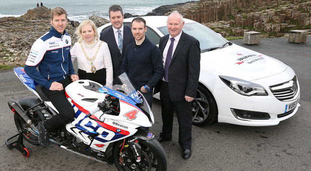 A Giant boost: Top road race stars Ian Hutchinson and Alastair Seeley with Vauxhall's Northern Ireland's Regional Operations Manager, Gordon Hannen, Mayor of Causeway Coast and Glens, Councillor Michelle Knight-McQuillan and NW200 Event Director Mervyn Whyte, MBE
