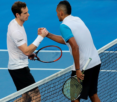 Turning the tables: Andy Murray congratulates Nick Kyrgios after the Australian defeated him for the first time
