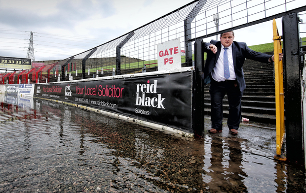 Wet, wet, wet: Glentoran director Simon Kitchen examines the flooding at the Oval