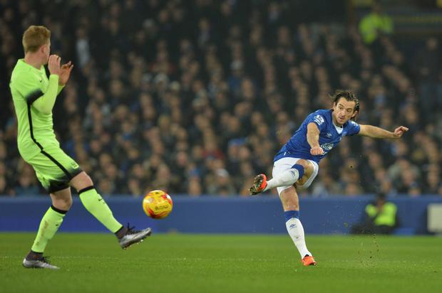 Everton's English defender Leighton Baines (R) plays the ball during the English League Cup semi-final first leg football match between Everton and Manchester City at Goodison Park in Liverpool, north west England on January 6, 2016. AFP PHOTO / PAUL ELLIS RESTRICTED TO EDITORIAL USE. No use with unauthorized audio, video, data, fixture lists, club/league logos or 'live' services. Online in-match use limited to 75 images, no video emulation. No use in betting, games or single club/league/player publications.PAUL ELLIS/AFP/Getty Images
