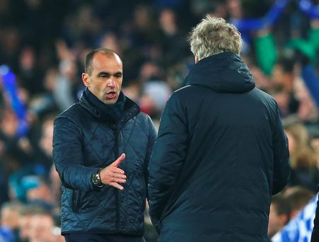 Shake on it: Everton boss Roberto Martinez shakes hands with Manuel Pellegrini after the first leg clash