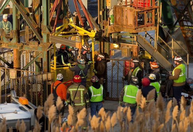 The last of 17 Cargill salt miners emerge Thursday, Jan. 7, 2016, after being rescued from an elevator stuck 900 feet below the surface at the Cayuga Salt Mine, in Lansing, N.Y. A rescue cage was lowered from a crane to bring them up four at a time. (Simon Wheeler/The Ithaca Journal via AP, Pool)