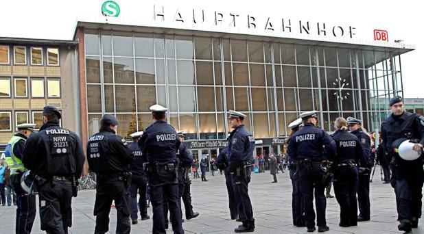 Police officers patrol in front of the main station of Cologne, Germany, on Wednesday, Jan. 6, 2016. More women have come forward alleging they were sexually assaulted and robbed during New Years celebrations in the German city of Cologne, as police faced mounting criticism for their handling of the incident. (AP Photo/Hermann J. Knippertz)