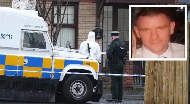 A murder inquiry is under way after the discovery of body in north Belfast. Inset: Murder victim Conor McKee