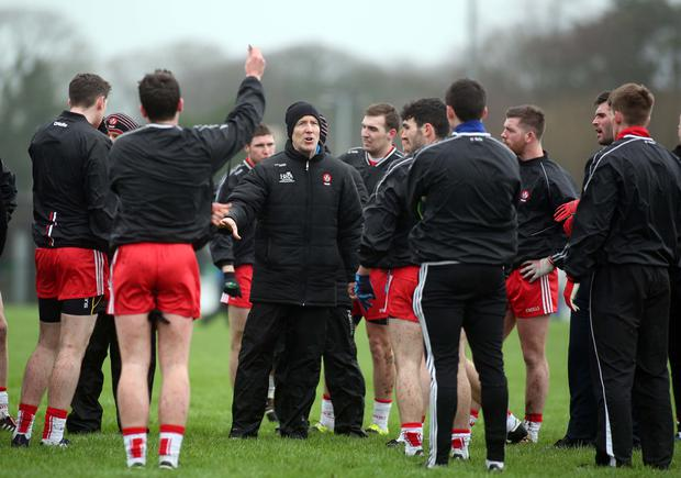 Centre of attention: boss Damian Barton instructs his Oak Leaf stars in training