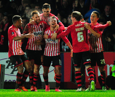 Gritty Grecians: Exeter City's Lee Holmes celebrates after scoring his side's second goal against Liverpool