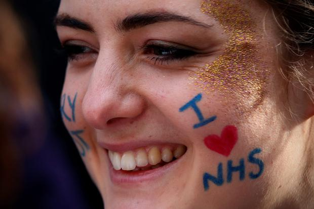 A student nurse takes part in a demonstration against government plans to scrap the NHS bursary on January 9, 2016 in London, England. (Photo by Carl Court/Getty Images)