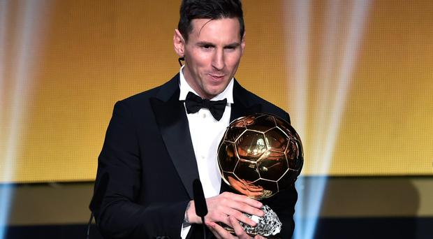 FC Barcelona and Argentina's forward Lionel Messi holds his trophy after receiving the 2015 FIFA Ballon dOr award for player of the year during the 2015 FIFA Ballon d'Or award ceremony at the Kongresshaus in Zurich on January 11, 2016. AFP PHOTO / FABRICE COFFRINIFABRICE COFFRINI/AFP/Getty Images