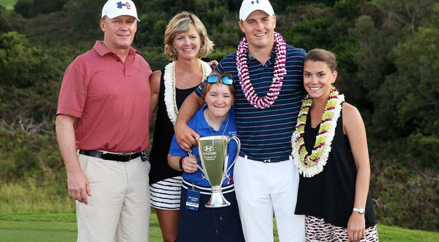 Early starter: Jordan Spieth celebrates his Hyundai Tournament of Champions victory with his family