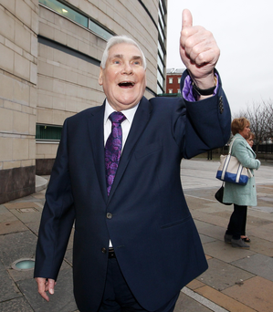 Pastor James McConnell leaves court in Belfast on January 5 after being found not guilty of making grossly offensive messages about Islam, which the firebrand evangelical preacher described as 'heathen', 'Satanic' and 'spawned in Hell'