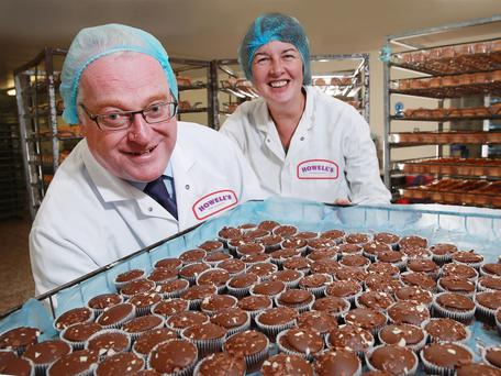 John Hopkins and Marion Sneddon from Irwin's Bakery with the company's Howell's Handmade range