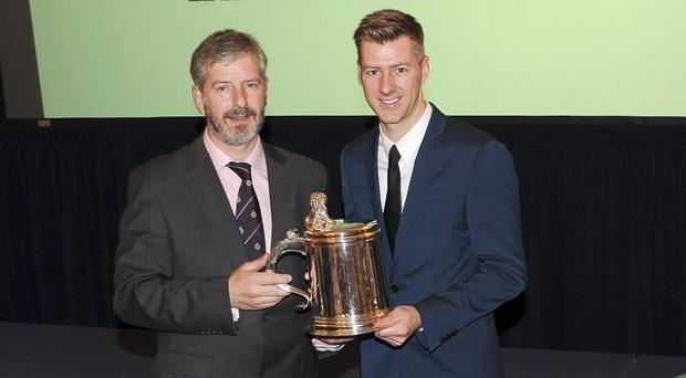 Prize guy: Ian Hutchinson picks up his Torrens Award from Torrens Committee chairman Barrie Baxter in London