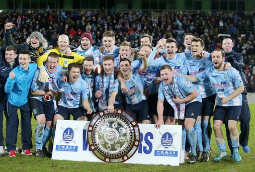 Ballymena celebrate as they lift the shield