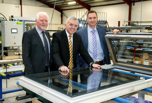 Wednesday 13th January 2016 Picture by Darren Kidd / Press Eye. Enterprise, Trade and Investment Minister, Jonathan Bell, is pictured with Austin McGillian, Chairman and Asa McGillian, Managing Director of Apeer, after announcing that the Ballymena window manufacturer is to create 25 new jobs in the town as part of a £1.7m investment.