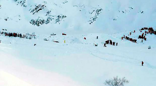 Rescuing teams gather for search and rescue operations on a piste at the avalanche site after skiers, including a group on a school outing, were swept away in the Les Deux Alpes resort in The French Alps on January 13, 2016. Two teenagers and a Ukrainian man were killed when an avalanche swept away skiers in the French Alps, including a group on a school outing, local officials said today. The avalanche hit a piste at the Deux-Alpes resort in eastern France that was still closed to the public, engulfing a group of nine French school children and their teacher from the city of Lyon, according to police sources. / AFP / STRINGERSTRINGER/AFP/Getty Images