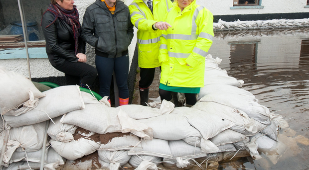 Minister O'Neill and David Porter, chief executive of the Rivers Agency at Meghan Ni Raifeartaigh's home at Derryall Portadown. Also in the photograph is Meghan's mum Cathy Rafferty