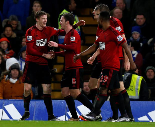 West Bromwich Albion's Irish midfielder James McClean (L) celebrates with teammates after scoring their second goal during the English Premier League football match between Chelsea and West Bromwich Albion at Stamford Bridge in London on January 13, 2016. AFP PHOTO / IAN KINGTON