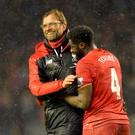 Liverpool's German manager Jurgen Klopp and Ivorian defender Kolo Toure celebrate after winning the English Premier League football match between Liverpool and Arsenal at Anfield stadium in Liverpool, north-west England on January 13, 2016. AFP/Getty Images