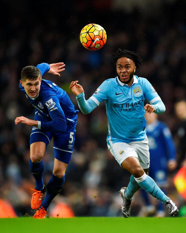 MANCHESTER, ENGLAND - JANUARY 13: Raheem Sterling of Manchester City and John Stones of Everton compete for the ball during the Barclays Premier League match between Manchester City and Everton at the Etihad Stadium on January 13, 2016 in Manchester, England. (Photo by Laurence Griffiths/Getty Images)
