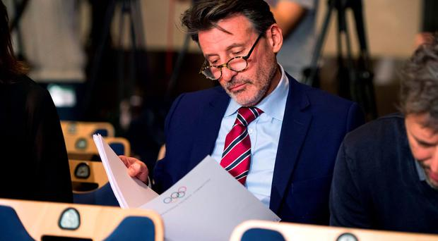 Close attention: Lord Coe reads the latest WADA report,