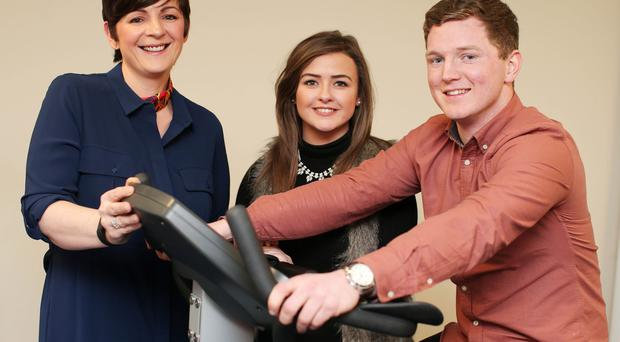 Press Eye - Belfast - Northern Ireland - 13th January 2016 Conleth McGrenaehan and his girlfriend Bronagh McGuckin present charity Brain Injury Matters, off the Castlereigh Road in east Belfast. Left to right. Family Practitioner with Brain Injury Matters Keelin White, Conleth and Bronagh Picture by Jonathan Porter/PressEye
