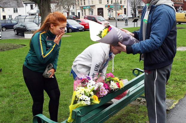 Friends and family lay flowers close to the scene of the fatal fire at Castlewellan, Co Down, where Ellen Finnegan (19) died in a flat above Finnegans butcher's shop. Pic Freddie Parkinson/Press Eye