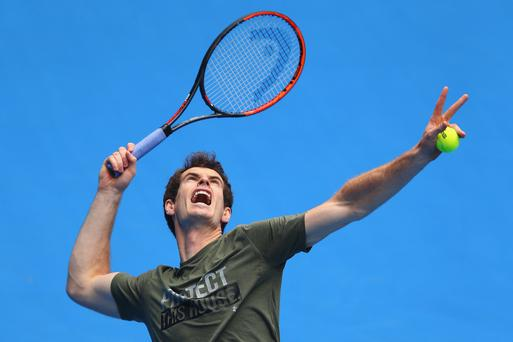 Serving up a treat: Andy Murray is gunning for Aussie Open glory but may have to drop out if wife Kim goes into early labour