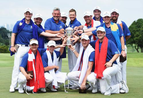 Champions: The Europe team, together with captain Darren Clarke, celebrate after winning the EurAsia Cup