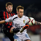 Eyes on the prize: Crusaders ace Billy Joe Burns gets his foot to the ball before Chris Lavery of Glentoran at Seaview