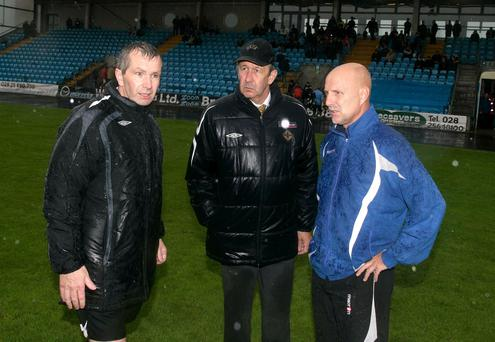 Referee Paddy McFadden and referees observer Herbie Barr with Ballymena manager Roy Walker in 2008