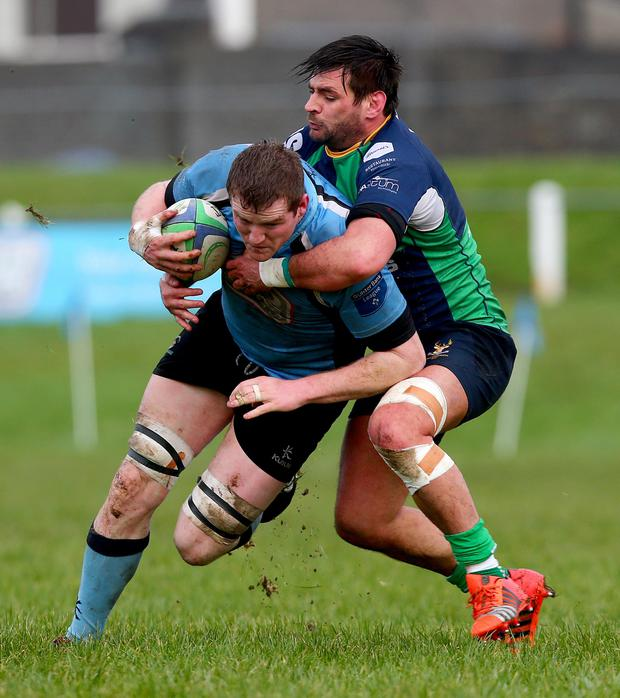 Holding on: Ballynahinch's David McGuigan in action