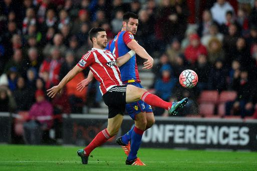 Southampton's Shane Long and Crystal Palace's Scott Dann (right) battle for the ball during the Emirates FA Cup, third round game at St Mary's, Southampton. Andrew Matthews/PA Wire.