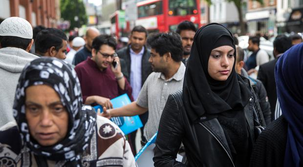 People leave the East London Mosque after attending the first Friday prayers of the Islamic holy month of Ramadan on June 19, 2015 (Photo by Rob Stothard/Getty Images)