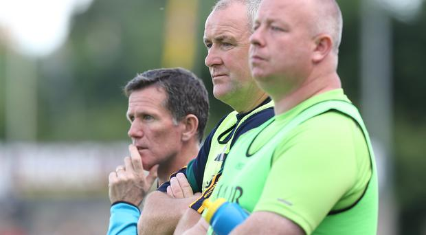 In the middle: Frank Fitzsimmons (centre) wants his county board to ask his players' opinion of proposed All-Ireland changes