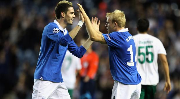 Old pals act: Kyle Lafferty will be allowed to leave Norwich after former Rangers team-mate Steven Naismith is brought in