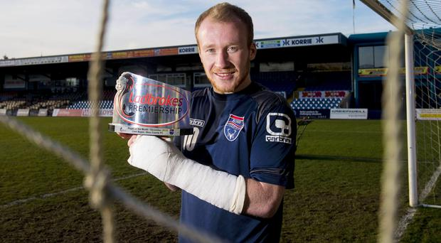 Prize fighter: Liam Boyce shows off his Scottish Premiership Player of the Month award at Ross County