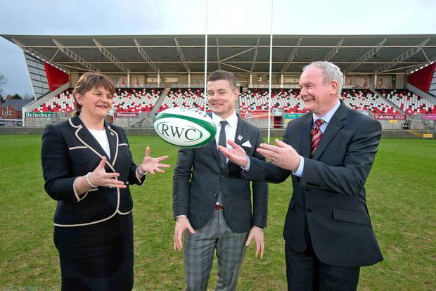 On the ball: First Minister Arlene Foster with Brian O'Driscoll and deputy First Minister Martin McGuinness