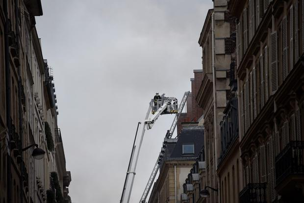 Firefighters work on extinguishing a fire at the Ritz Hotel in Paris on January 19, 2016. A major fire broke out at the landmark Paris Ritz hotel, which is closed for renovations, the fire service said.
