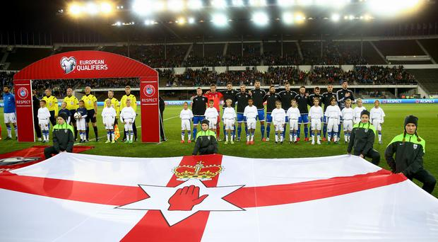The Northern Ireland international football team line up to God Save the Queen ahead of fixtures.
