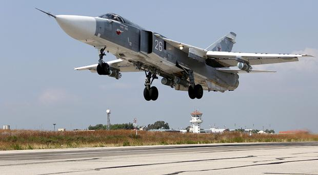 A Russian SU-24M jet fighter takes off from an airbase Hmeimim in Syria (Russian Defense Ministry Press Service via AP)